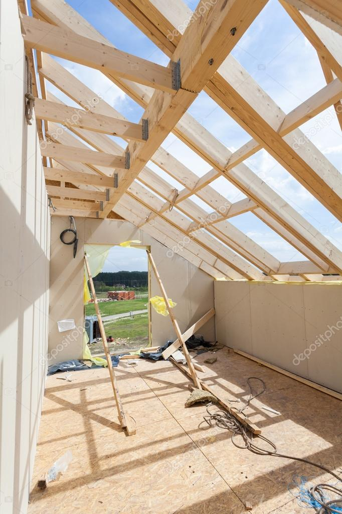 attic room under construction with gypsum plaster boards roofing construction indoor wooden. Black Bedroom Furniture Sets. Home Design Ideas