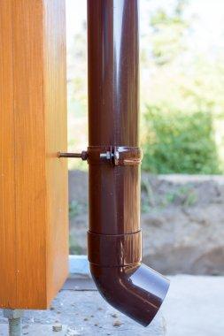 Brown copper gutter closeup