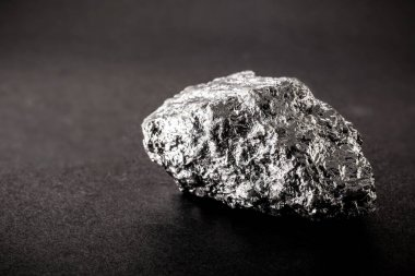 Manganese ore, used in the manufacture of metal alloys, combined, especially with iron, in the production of steel.