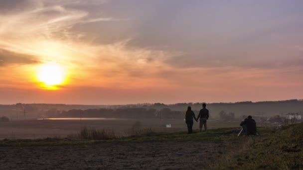Filmmaker working with models at sunset 4K