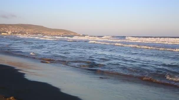 Wave crashing Caspian sea beach in Baku