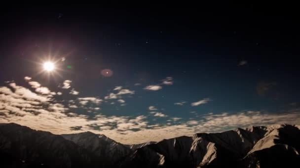 Timelapse stars and moon in mountain night sky. Moonrise