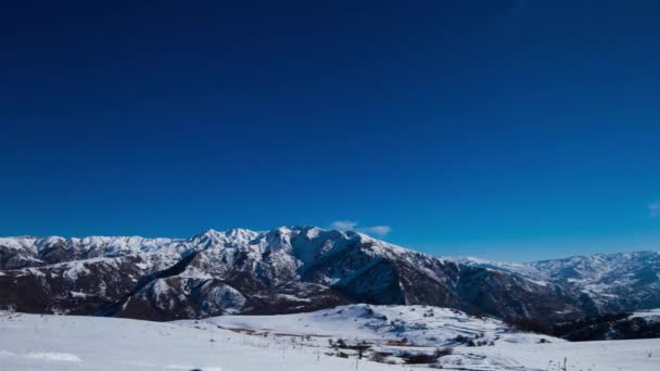 Snowy mountains.movement of clouds over the snowy peaks, Timelapse blue sky