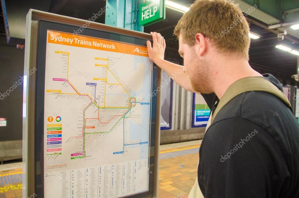 Man looking at the Sydney Trains Rail Network Map – Stock ...