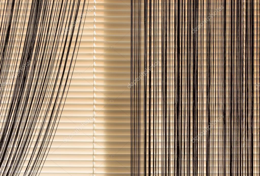 Corda di tapparelle e tende beige foto stock sv for Tende beige e marrone