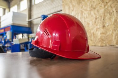 Red hard hat on a table.