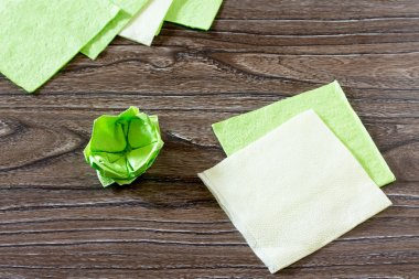 The child fold a square of paper. The child makes crafts out of