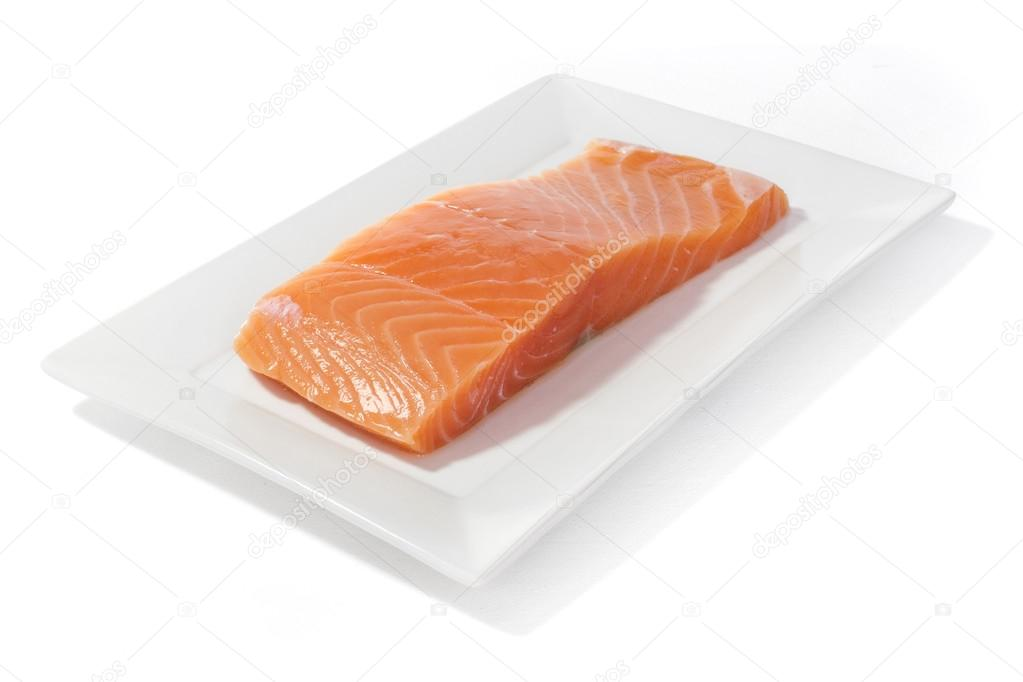 salmon fish meat on dish isolated in white background