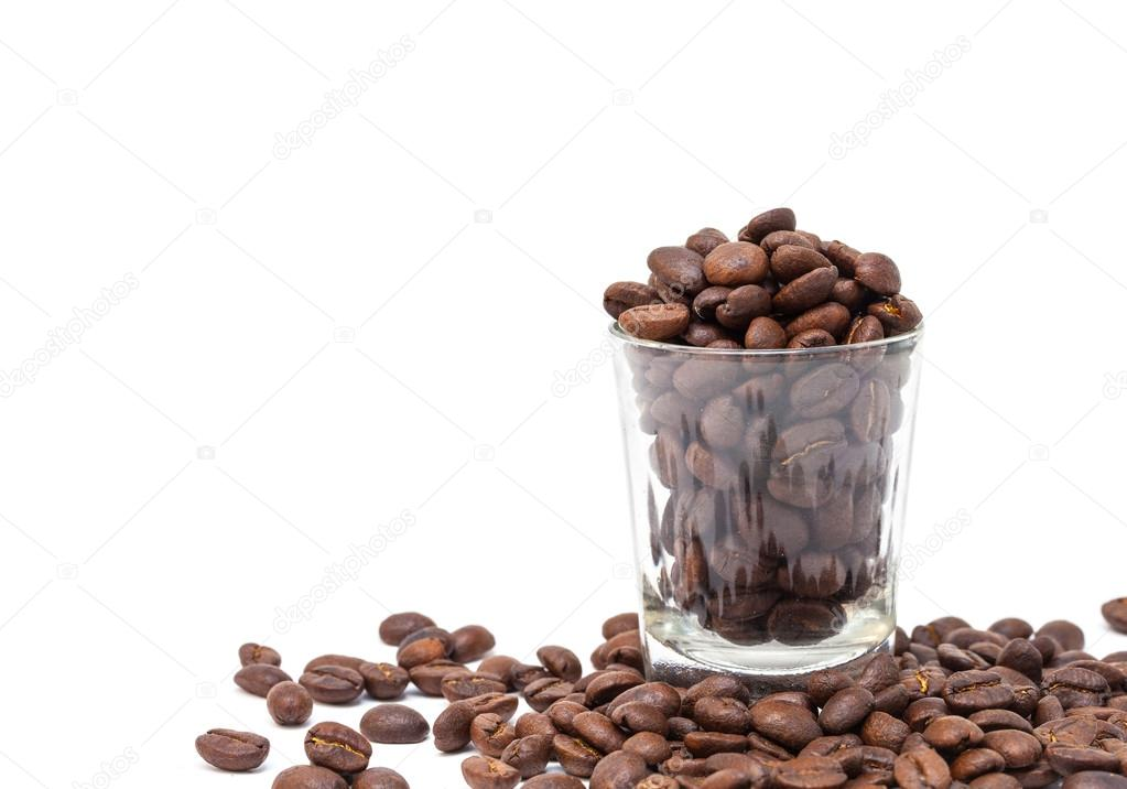 coffee beans in glass shot isolated on white background