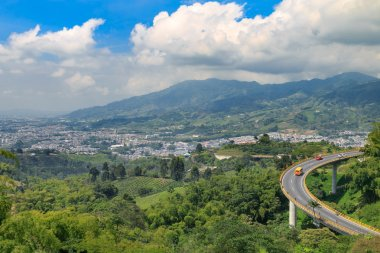 landscape with road and green mountains, colombia, latin america