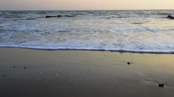 Calm evening surf at Atlantic Ocean coastline