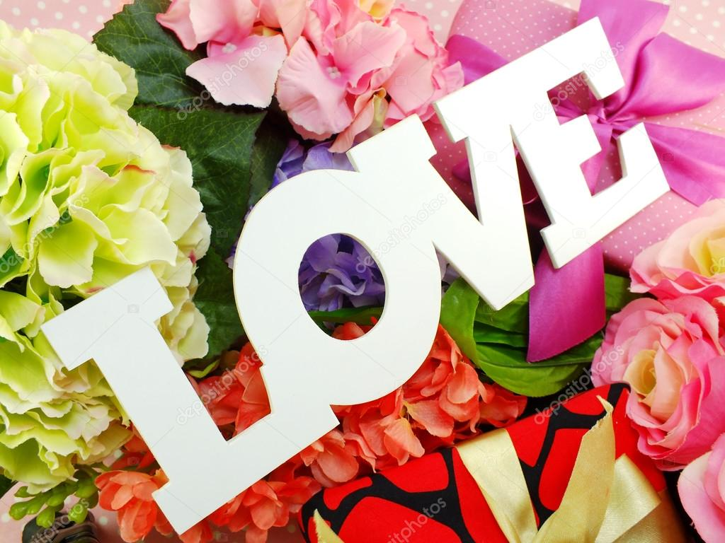 Text Love Word Copy With Gift And Flower Close Up Photo By May