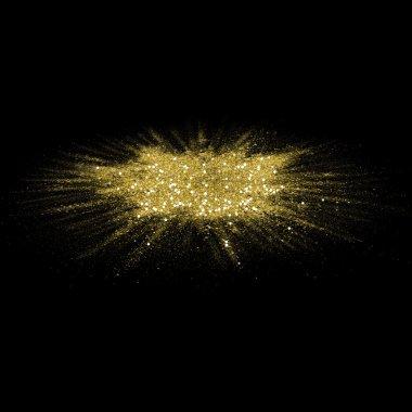 Gold glitter powder scattered on black background.