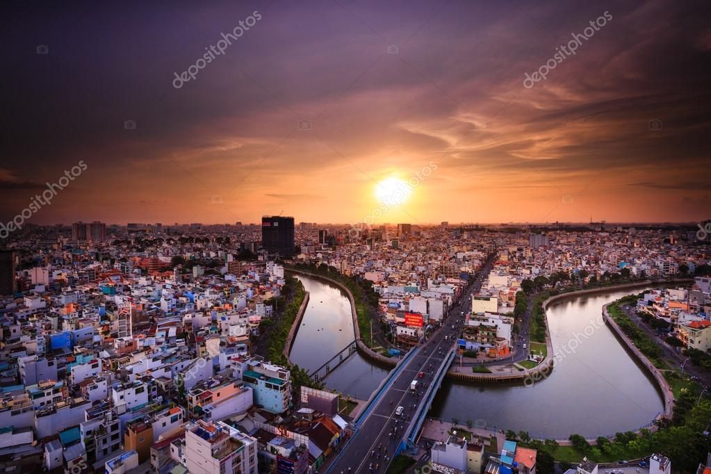 Hochiminh City, Vietnam - July 24, 2015: Saigon riverside with the road across the canal and houses Multiple Loc, Ho Chi Minh City, Vietnam. The shape look like a archery
