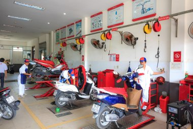 Hochiminh City, Vietnam - June 23, 2015: professional motorcycle repairman at a service center of Honda motorcycles in Ho Chi Minh City, Vietnam