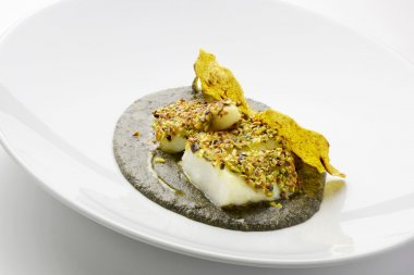 Salt cod crusted with pistachios and black polenta