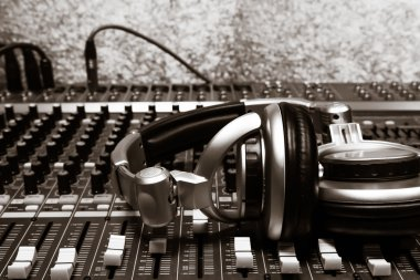 the beautiful headphone on sound mixer music background.