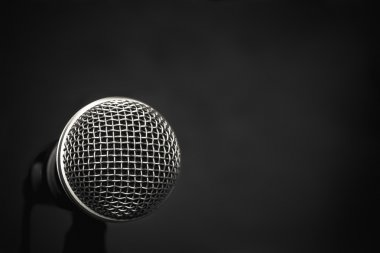 Microphone on wallpaper  background.