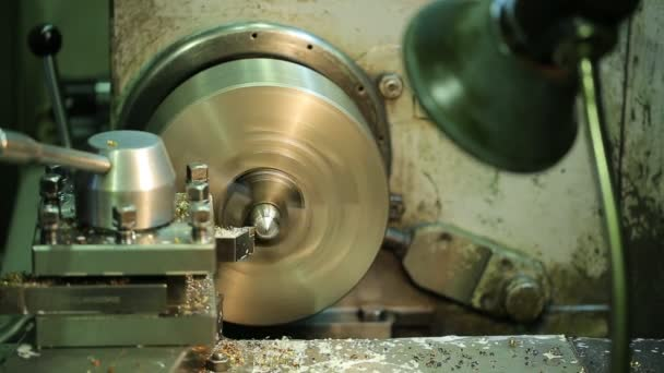 Old dirty machine stops after milling of workpiece.