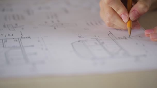 It is close up image of correcting blueprint or plan of building or house