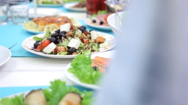 White ceramic plates are filled with delicious food.