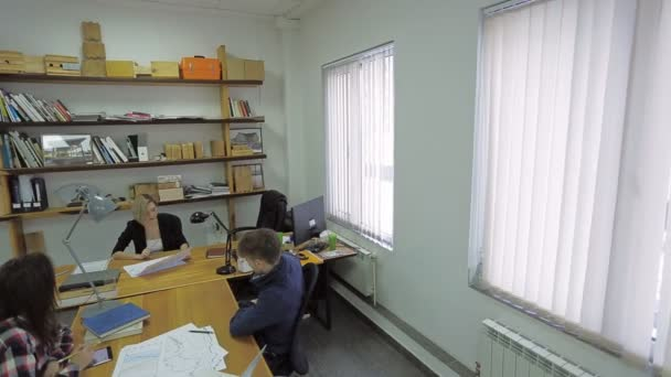 Couple dealing with her a Attractive financial adviser in her working office