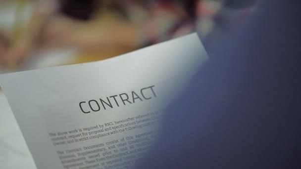read Business Contract, Mutual Agreement, in blurring the background