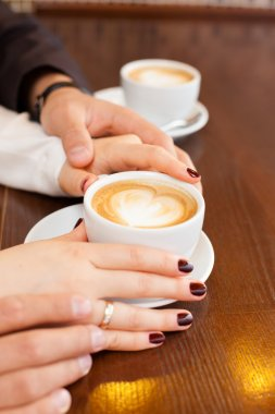 cup of coffee and hands newlywed
