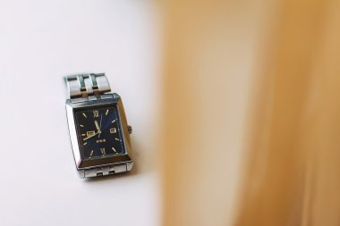 man's watch on a table