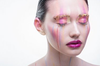 Beautiful girl with closed eyes and colorful splashes