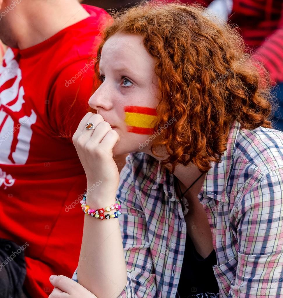 with drawing spanish flag on her face u2013 stock editorial photo