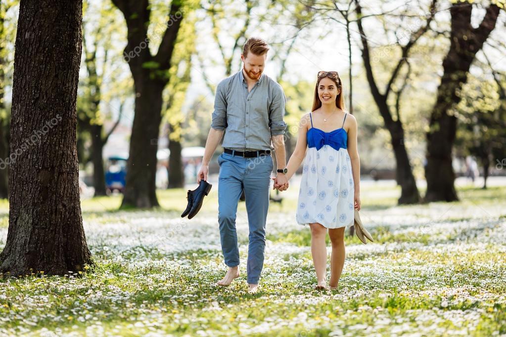https://st2.depositphotos.com/5392356/10912/i/950/depositphotos_109124682-stock-photo-beautiful-couple-in-park-taking.jpg