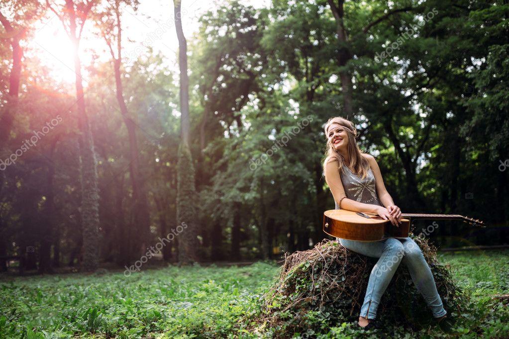 Happy female guitar player