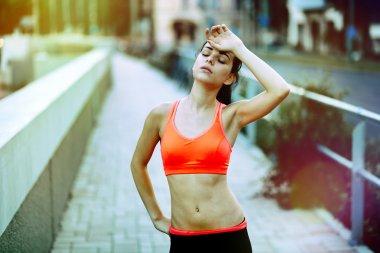 Tired female jogger resting