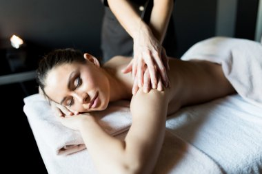 Lady having her shoulder and body massaged
