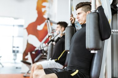 Handsome men working out in a  gym