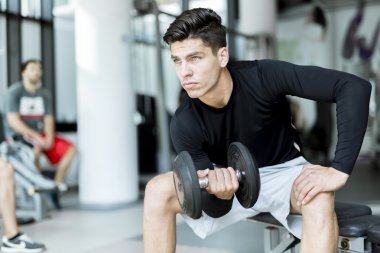 Young man training in a gym