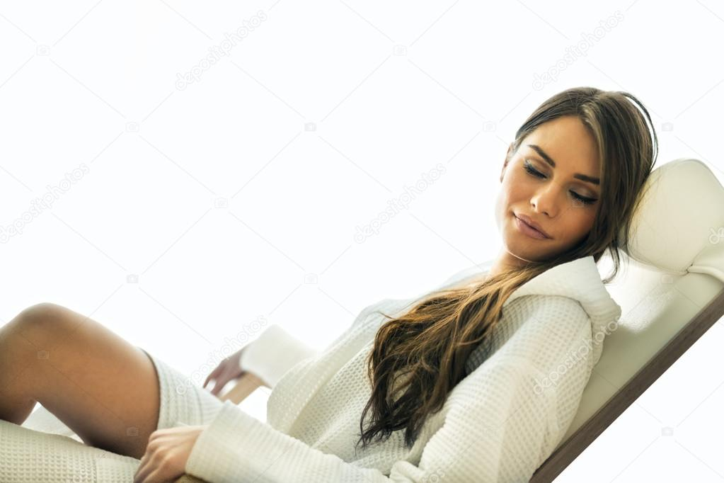 Sexy woman relaxing in a chair
