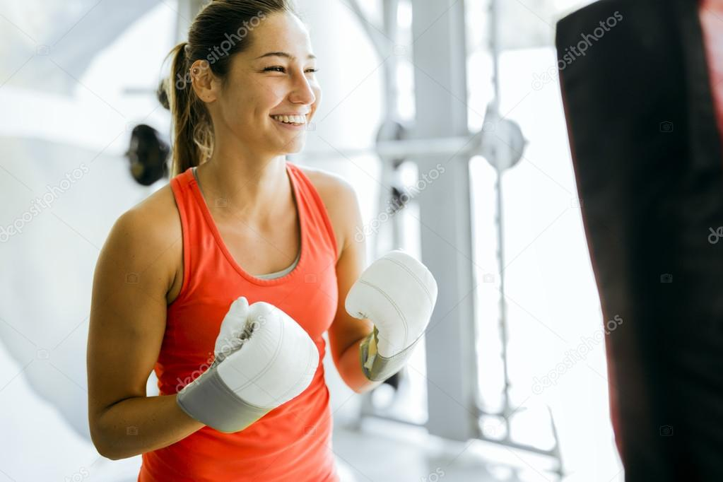 Young woman boxing and training