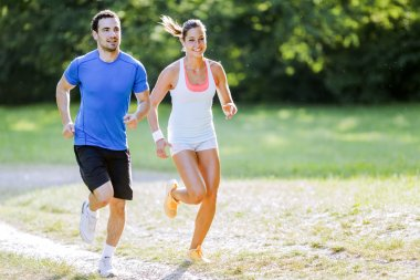 Young people jogging in nature