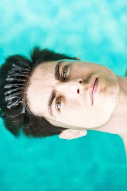Handsome man floating on water