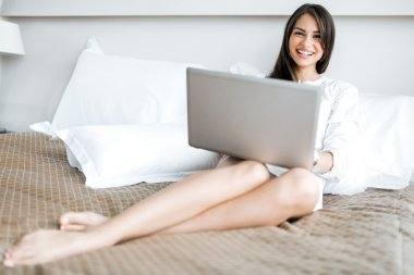 Beautiful woman using a laptop