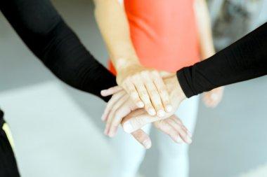 Three hands touching representing teamwork