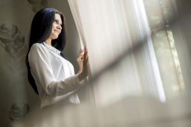Happy woman staring out the window