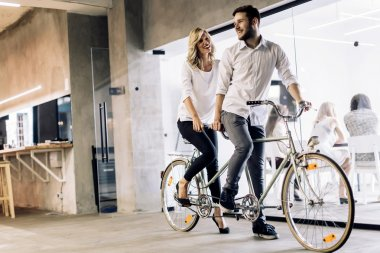 businesspeople riding on twin bicycle