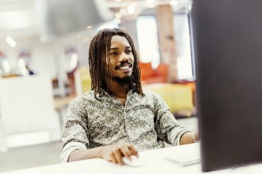 black man working on computer