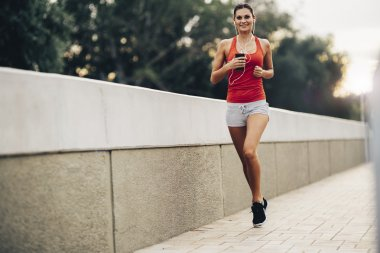 Woman jogging in city