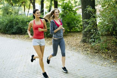 Young fit women jogging outdoors