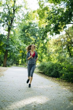 Young blonde woman jogging