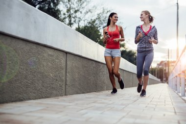 Two women exercising by jogging